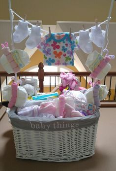 Here's a Pinterest inspired baby shower gift I made for one of my girlfriends. I combined some items like Dreft laundry soap, Pampers, wipes, with some handmade gifts like, a blanket, burp pads, a nursing shawl, reuseable breast pads and hand embelished onesies. It was a huge success.