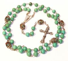 I love the beads in this Rosary.