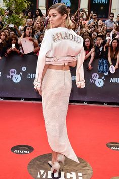 MuchMusic Video Awards in Canada, Gigi Hadid styled her Mikhael Kale skirt and crop top ensemble with a personalised jacket - June 21, 2015