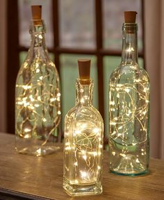 Give new life to your empty wine bottles with a Set of 3 Wine Bottle Stopper String Lights. These lights transform any bottle into a romantic mood light, w # diy wedding decorations Sets of 3 Wine Bottle Stopper String Lights Wine Bottle Stoppers, Wine Bottle Crafts, Wine Bottle Corks, Alcohol Bottle Crafts, Wine Decanter, Our Wedding, Dream Wedding, Light Wedding, Perfect Wedding