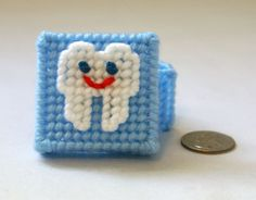 Cute idea  Tooth fairy box in plastic canvas (baby blue). $4.00, via Etsy.