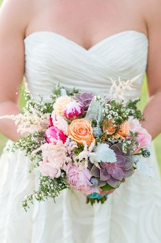 summer bouquet with purple succulents - photo by Rebecca Ellison Photography http://ruffledblog.com/coral-and-mint-dallas-wedding