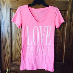 Love is all we need Tshirt Soft. Slightly shear. Live love dream Tops
