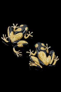 Whimsical frog brooches in 18k yellow gold with yellow diamonds, black enamel and cabochon emerald eyes are the perfect blend of playful and elegant.
