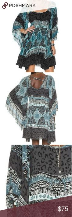 FreePeople Heart of Gold Dress New with tag. Size xs. STYLE # OB395273   DESCRIPTION: This vintage inspired Free People Heart of Gold Dress will have you dancing the night away at your favorite show.   FEATURES: 100% Rayon  Wide bell sleeve Crisscross back Machine Wash Cold Free People Dresses Mini