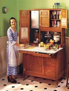 """Hoosier (baker's) cabinet... """"'Hoosiers"""" are distinguished by special features such as pull-out porcelain work areas, large flour bins, sugar bins, tin bread drawers, spice jars, pot and pan racks and many other features"""
