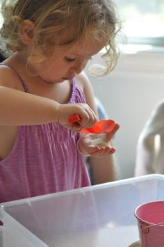 Sand Sensory Play ~ Exploring her sense of touch, a child can discover the wonderful texture of sand.