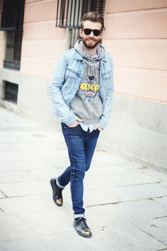 Shop this look for $150:  http://lookastic.com/men/looks/longsleeve-shirt-and-hoodie-and-denim-jacket-and-jeans-and-low-top-sneakers/1151  — Light Blue Longsleeve Shirt  — Grey Print Hoodie  — Light Blue Denim Jacket  — Blue Jeans  — Black Leather Low Top Sneakers
