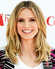 Do you like the messy look of Heidi Klum's All-Over Layers?  Pinned by Sleekhair.com