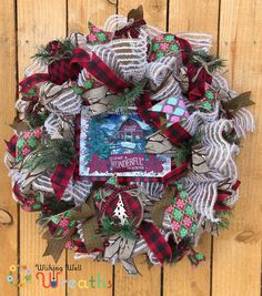 "THis beautiful burlap country Christmas Wreath is perfect for any home especially if you're a fan of the farmhouse style! This Farmhouse Christmas Wreath is covered in beautiful ribbons of snowflakes, red and green plaid, and the famous buffalo plaid. This country Christmas wreath comes with a rustic sign of a barn and evergreen trees with a sleigh and words reading ""The most wonderful time of the year""! The wreath is also covered in a snowy looking burlap. Halloween Door Wreaths, Christmas Mesh Wreaths, Burlap Christmas, Country Christmas, Halloween Decorations, Christmas Decorations, White Christmas, Winnie The Pooh Decor, Wreaths For Sale"