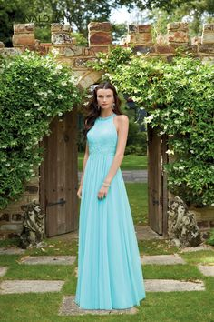 A FLOOR LENGTH NET BRIDESMAID DRESS WITH A LACE APPLIQUED WAISTBAND AND A BEADED COLLAR