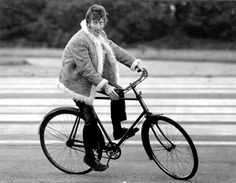 John Lennon rides a bike. He wrote my fav song of all time: Imagine