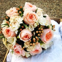 Beautiful English garden roses and hypericum berries peaches and creams