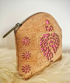These small cork coin purse with pink heart is very original and unusual! Perfect and unique eco-friendly present.    Features:    - Made from Cork-Eco-friendly material    - Soft and durable    - One color      External size: 13x13x3cm.    How to clean cork?    - Cork is stain and water resistant.  - Cork is very easy to maintain as new, just need to clean with a dump soft cloth.  - Cork is a natural material, recyclable and biodegradable, made in Portugal.      *Colours may differ…