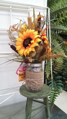 Different variations of sunflower mason jar arrangements