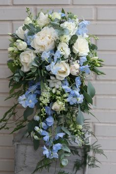 Peony, rose and delphinium cascading bouquet. Please contact The Stockbridge Flower Company, Edinburgh for more details.