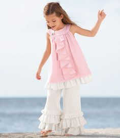 pink blush sundress A cascade of pretty pink ruffles adorns the front of this dress, creating a sweet and timeless look. It has a double layer of linen with a circle yoke that buttons on the side, and contrasting ruffles at the hem. Linen, linen-rayon. Hand wash. Made in USA.
