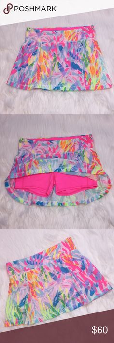 NWOT Lilly Pulitzer Luxletic Josephine Skort This skort is in perfect condition. Tags were removed but item was never worn. Beautiful bright colors with attached hot pink shorts underneath. Lilly Pulitzer Shorts Skorts