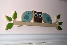 Wooden Birds and Owl for over the door. I suppose could be done in another medium too!