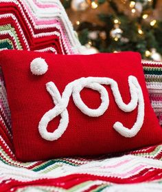 "Holiday JOY Pillow Free Knitting Pattern from Red Heart Yarns - Add the perfect JOY-ful note to your holiday décor! Simply knit the pillow cover, then make a Stockinette Stitch strip and a pompom for ""JOY"". This wonderfully effective idea can be used for monograms or any holiday message you prefer!"