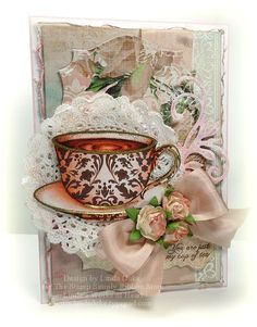 By: Linda Duke    This card was created using Spellbinders Label Fourteen, Label Twenty-Five and Floral Flourishes.  http://lindaduke.typepad.com/lindas_works_of_heart/2012/04/ribbon-inspirationstamp-simply-style-coffee-tea-or-me.html