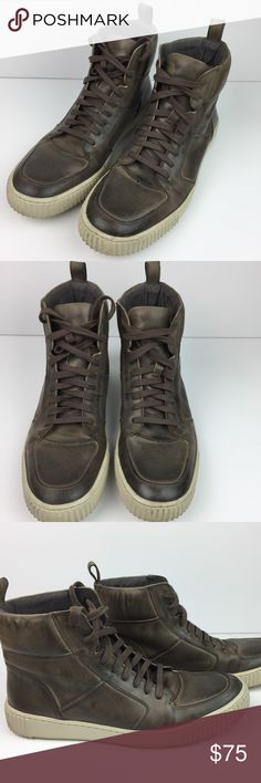 John Varvatos Bedford High Top Fashion Sneaker I am selling a pair of Men's John Varvatos Bedford High Top Fashion Sneaker in size 9M. This shoe features dark brown leather, rubber sole, distressed leather upper, lace front with blind eyelets, and pull-on tab. They were worn only twice and are in like new condition. No defects! Smoke-free, pet-free home. FAST SHIPPING! John Varvatos Shoes Sneakers