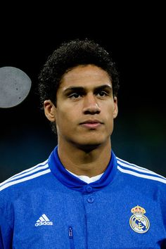 Raphael Varane Photos Photos - Raphael Varane of Real Madrid CF looks on standed at the squad«s line up  prior to start  the UEFA Champions League Group B match between Real Madrid CF and PFC Ludogorets Razgrad at Estadio Santiago Bernabeu on December 9, 2014 in Madrid, Spain. - Real Madrid CF v PFC Ludogorets Razgrad