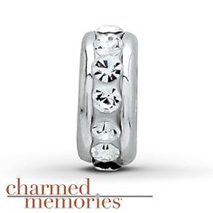This Charmed Memories® spacer charm features clear SWAROVSKI ELEMENTS and is crafted of sterling silver.