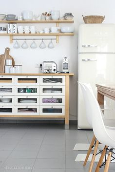kitchen in bright & simple white, gray, with light wood tone open shelving & trim.  just add your favorite accent color.
