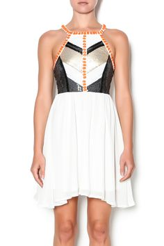 Gold, black & white Sequin top embellished with large orange stones and a solid white chiffon bottom. Cage back with zipper.   Cage Back Sequin Dress by Xenia Boutique. Clothing - Dresses - Casual Palm Beach, Florida