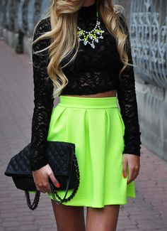 cropped black lace top and girlie neon skirt...the statement necklace really completes this look!  <3