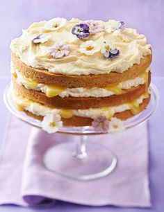 A showstopping, lemony sponge cake with a delicious lemon curd icing and beautiful edible crystallised violets and primroses on top