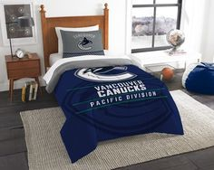 Vancouver Canucks NHL Draft Twin Comforter and Sham Set. Includes 1 Sham and 1 Twin Comforter. Visit SportsFansPlus.com for Details.