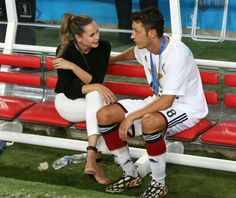 Midfielder Mesut Ozil talking with his girlfriend Mandy Capristo: