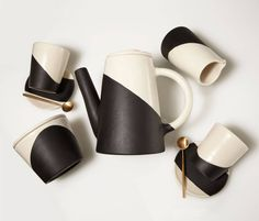 The hand-thrown porcelain tea service from New York's Apparatus Studio bears a bold two-tone motif. The set of four cups and saucers, teapot, sugar bowl, creamer, and four brass spoons