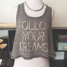"Follow Your Dreams gold foil cropped tank top NWT ""Follow Your Dreams"" cropped tank top. Color: heather grey with gold foil and white writing. Material: 60% cotton/40% polyester. Size: junior's large. Would work on small/medium as well depending on how loose fitting you like it. From a pet free and smoke free home. Taylor & Sage Tops Tank Tops"