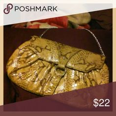Adrianna papell clutch This is the go to item when you wanna make your outfit pop! Perfect for an evening out on the town...or on a dinner date for two....this clutch is very versatile you can dress it up or dress it down with some blue jeans and sandals. Either way-very cute. Inside and outside pretty clean. There is what looks like an E written in red pen on inside of clutch. Slightly used . very good condition. Adrianna Papell Bags Clutches & Wristlets