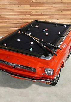 Mustang Pool Table - Play a game of billiards on one of the greatest pony cars to ever grace the auto industry – the 1965 Ford Mustang. These custom made Mustang Pool Tables comes with real chrome bumpers, working head lights, real tires, and real wheels. Ford Mustang 1965, Mustang Cars, Red Mustang, Ford Mustangs, Car Ford, Billard Snooker, Billard Table, Car Furniture, Modern Furniture