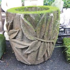 Lava stone pot from Bali. When kept in shade and moist it will grow moss. Mariani Gardens, marianigardens.com