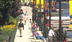 2011 Great Places in America: Public Spaces-Milwaukee RiverWalk, Milwaukee, Wisconsin. The Milwaukee RiverWalk was planned as a down-to-earth public space where residents could take peaceful walks, dine outdoors, and access the river. It has been more successful than anyone involved with the unique public-private initiative ever imagined. The RiverWalk is thronged with pedestrians taking advantage of a cleaner river and fresh air.   Photo courtesy of the Department of City Development.