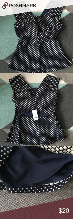 Banana republic polka dot top /cut out sz 4 Very flattering dark navy blue and white polka dot top. Sleeveless. Crisscross back with cut out. Great for work! Fabric feels like an upholstery so the top keeps its shape nicely. Lined. Side zipper. Fabric reads 71% cotton 29% polyester. Bust 16.5inches waist 13 inches total length 23 inches. Banana Republic Tops Blouses