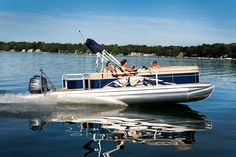 2013 Bennington Pontoon Boat 24 SSL making waves. Great for tubing or other watersports!