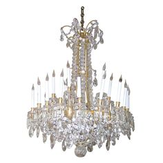 19th Century Signed Baccarat Crystal Chandelier with structure in gilt bronze, 28 lights.