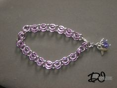 General Cancer Awareness bracelet with stunning lavender accents. Handcrafted by Divine Inspirations Jewelry  Check out my Etsy shop: https://divineinspir8ions.etsy.com Or my facebook: www.facebook.com/pages/divine-inspirations-jewelry/119517998156621