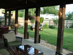 Rustic Charm ~ back porch using recycled railroad ties.