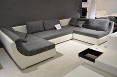 Large choice of refurbished sofas, armchairs and loungers in different designs for only 100.00 Euro per piece!