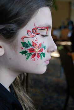 Beautiful poinsettia Christmas or winter face painting.