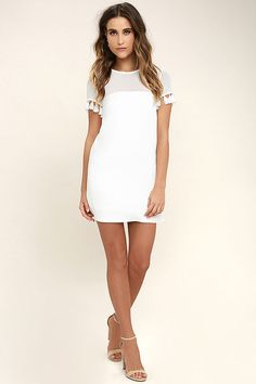 Give your wardrobe a cool and refreshing kick with the Iced Latte White Shift Dress! Sheer mesh forms a rounded neckline, decolletage, and tassel-trimmed short sleeves. Woven bodice has a darted, shift silhouette. Hidden side zipper.