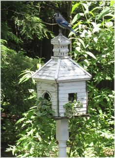 Weathered white birdhouse via An Enchanted Cottage