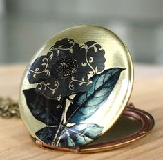 FLOWER AND SCROLL- brass, image, locket by AmberSky
